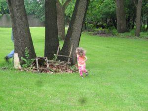 Kezzie chasing Papa around %22the three sisters%22 tree