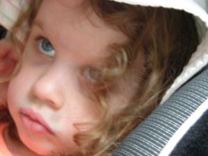 Kezzie:eye's up:closeup in car w:hat