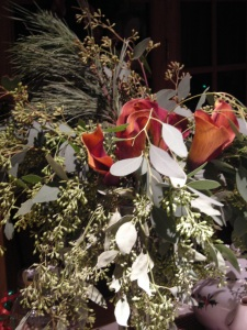 Calla lilies and greens in vase